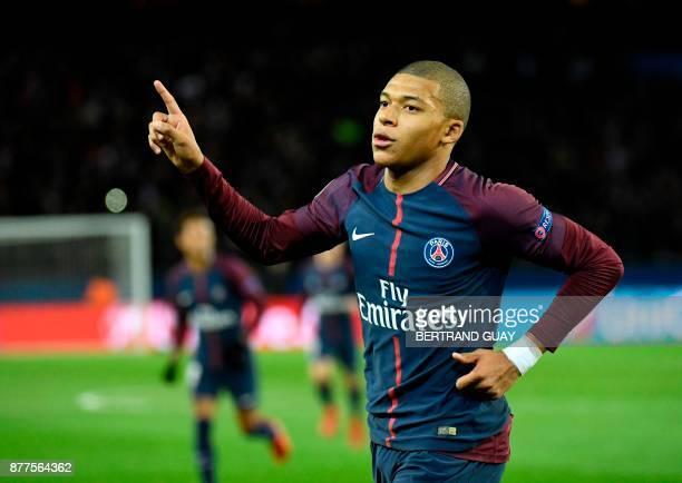 Paris SaintGermain's French striker Kylian Mbappe celebrates scoring his team's fourth goal during the UEFA Champions League Group B football match...
