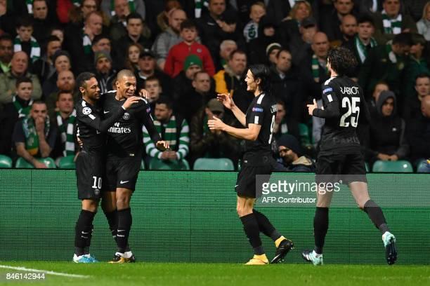 Paris SaintGermain's French striker Kylian Mbappe celebrates with Paris SaintGermain's Brazilian striker Neymar Paris SaintGermain's Uruguayan...