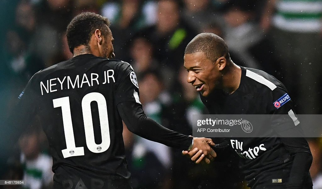 Paris Saint-Germain's French striker Kylian Mbappe (R) celebrates with Paris Saint-Germain's Brazilian striker Neymar after scoring their second goal during the UEFA Champions League Group B football match between Celtic and Paris Saint-Germain (PSG) at Celtic Park in Glasgow, on September 12, 2017. /