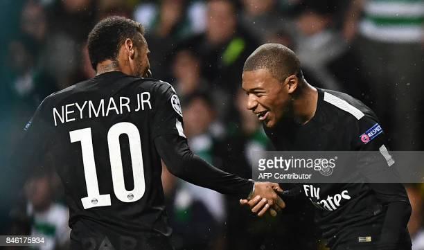 Paris SaintGermain's French striker Kylian Mbappe celebrates with Paris SaintGermain's Brazilian striker Neymar after scoring their second goal...