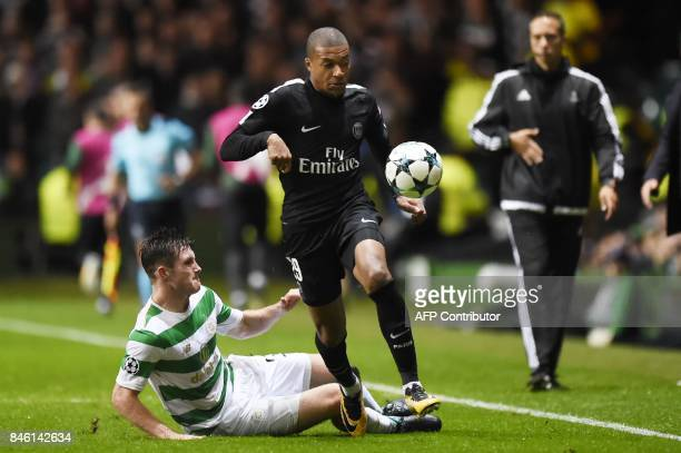 Paris SaintGermain's French striker Kylian Mbappe runs away from Celtic's Scottish defender Anthony Ralston during the UEFA Champions League Group B...