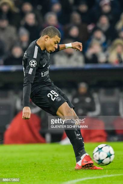 Paris SaintGermain's French striker Kylian Mbappe shoots during the UEFA Champions League football match between Paris SaintGermain and Bayern Munich...