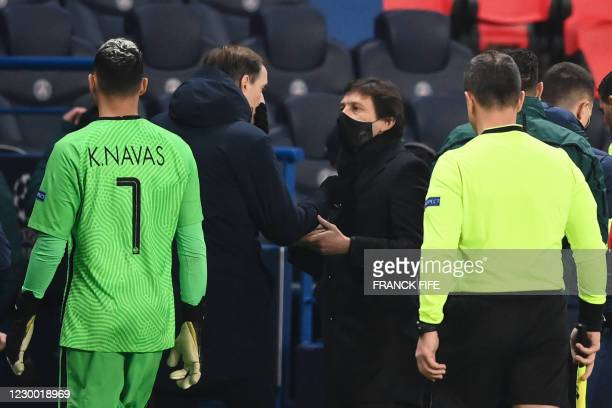 Paris Saint-Germain's German coach Thomas Tuchel and Paris Saint-Germain's Brazilian sporting director Leonardo chat after the game was suspended...