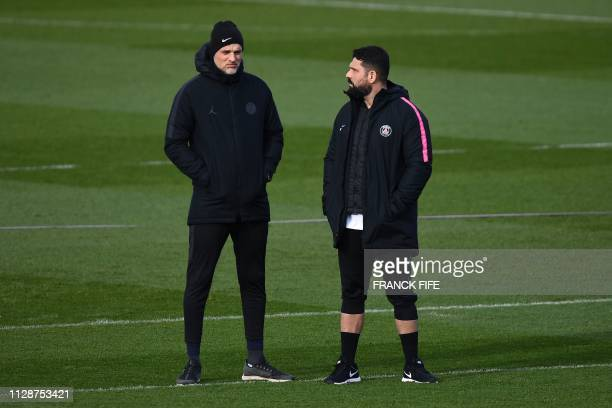 Paris SaintGermain's German coach Thomas Tuchel chats with a staff member during a training session at the club's Camp des Loges training grounds in...