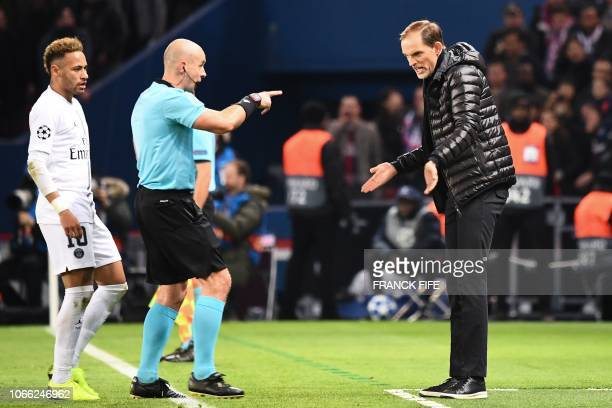 Paris Saint-Germain's German coach Thomas Tuchel reacts and argues with Polish referee Szymon Marciniak during the UEFA Champions League Group C...