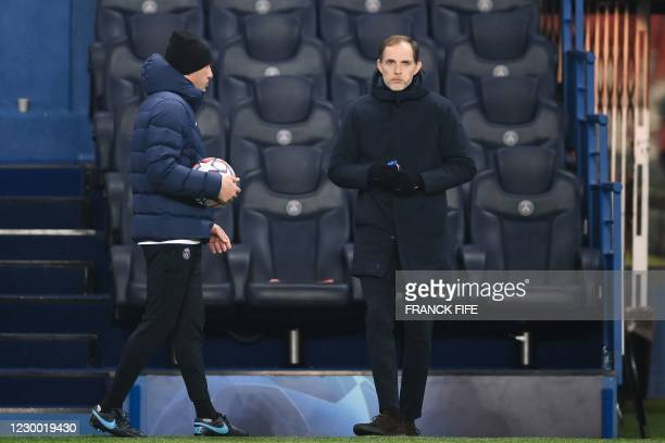Paris Saint-Germain's German coach Thomas Tuchel waits after the game was suspended in the first half as the players walked off amid allegations of...