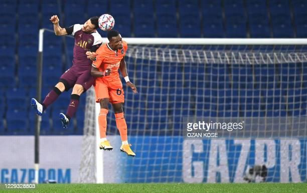 Paris Saint-Germain's German defender Thilo Kehrer fights for the ball with Istanbul Basaksehir's Belgian defender Boli Bolingoli during the UEFA...