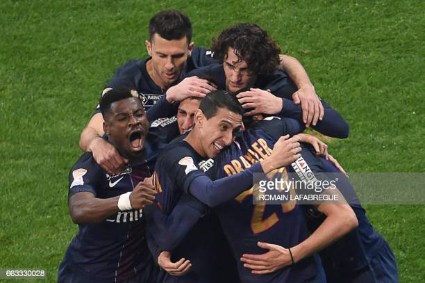 Paris SaintGermain's German forward Julian Draxler celebrate teammates after scoring a goal during the French League Cup final football match between...