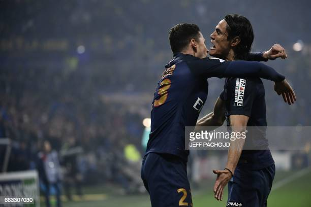 Paris SaintGermain's German forward Julian Draxler celebrate with Paris SaintGermain's Uruguayan forward Edinson Cavani after scoring a goal during...