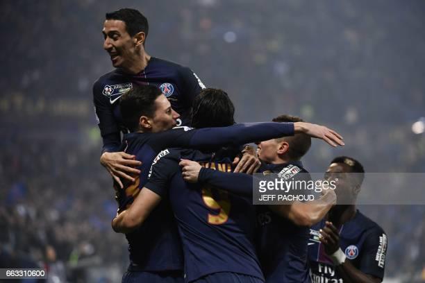 Paris SaintGermain's German forward Julian Draxler celebrates with teammates after scoring a goal during the French League Cup final football match...