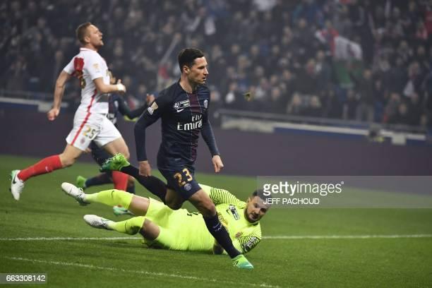 Paris SaintGermain's German forward Julian Draxler reacts as he scores a goal past Monaco's Croatian goalkeeper Danijel Subasic during the French...