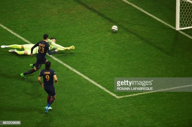 Paris SaintGermain's German forward Julian Draxler shoots and scores a goal past Monaco's Croatian goalkeeper Danijel Subasic during the French...