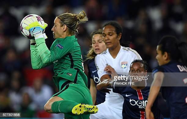 Paris SaintGermain's German goalkeeper AnnKatrin Berger catches the ball during the UEFA Women's Champions League semifinal second leg football match...
