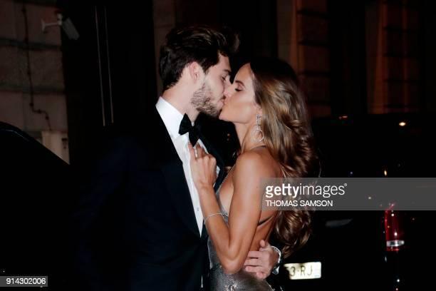 Paris SaintGermain's German goalkeeper Kevin Trapp and girlfriend Brazilian model Izabel Goulart kiss as they arrive at the Pavillon Cambon in Paris...