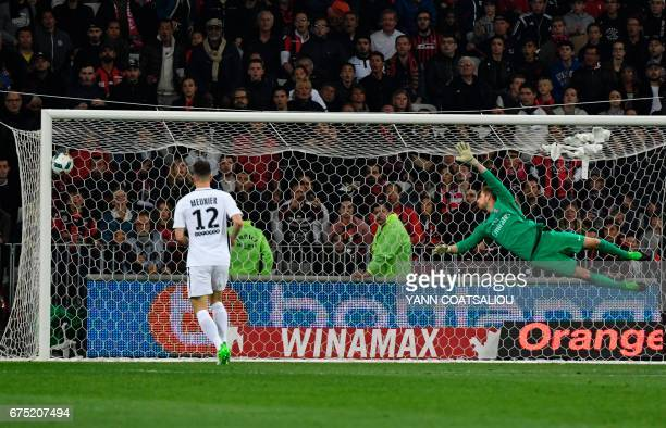 Paris SaintGermain's German goalkepper Kevin Trapp jumps for the ball during the French L1 football match Nice vs Paris Saint Germain on April 30...