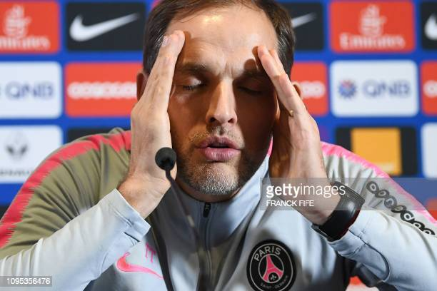 Paris SaintGermain's German head coach Thomas Tuchel gestures as he addresses a press conference at the team's training grounds in SaintGermainenLaye...