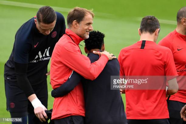 Paris SaintGermain's German head coach Thomas Tuchel greets Paris SaintGermain's Brazilian forward Neymar during a training session in...