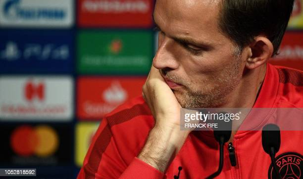 Paris SaintGermain's German head coach Thomas Tuchel reacts as he gives a press conference at the Parc des Princes stadium in Paris on October 23...