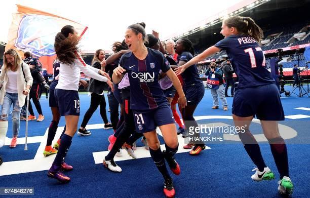 Paris SaintGermain's German midfeilder Fatmire Alushi Paris SaintGermain's Spain midfielder Veronica Boquette and Paris SaintGermain's French...