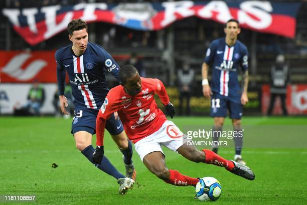 Paris Saint-Germain's German midfielder Julian Draxler and Brest's French midfielder Ibrahima Diallo vie for the ball during the French L1 football...