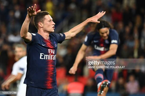 Paris Saint-Germain's German midfielder Julian Draxler celebrates after scoring a goal during the French L1 football match between Paris...