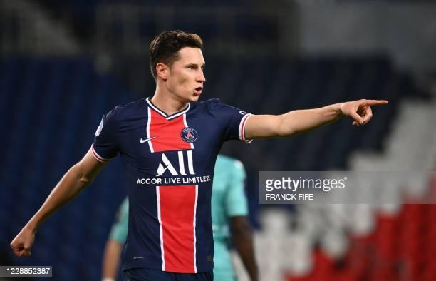 Paris Saint-Germain's German midfielder Julian Draxler celebrates after scoring his team's fourth goal during the French L1 football match between...