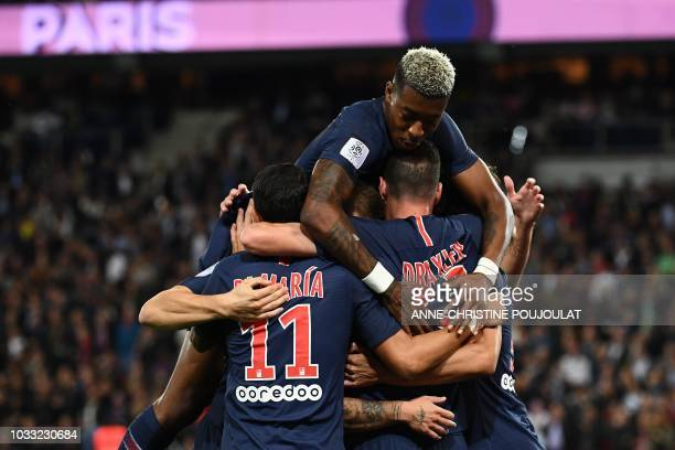 Paris Saint-Germain's German midfielder Julian Draxler celebrates with teammates after scoring a goal during the French L1 football match between...