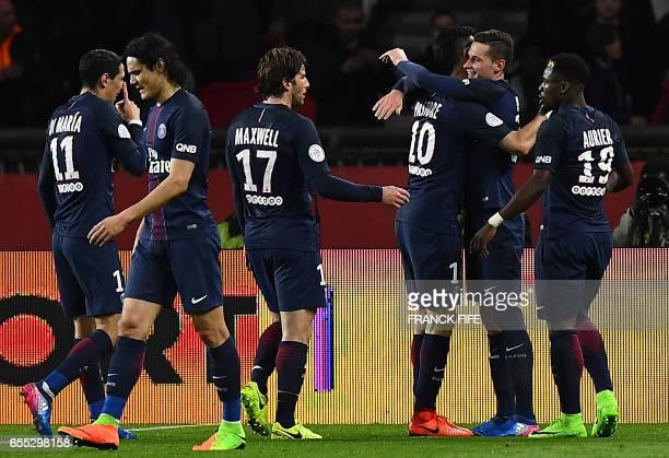 Paris SaintGermain's German midfielder Julian Draxler celebrates with Paris SaintGermain's Argentinian forward Javier Pastore and Paris...