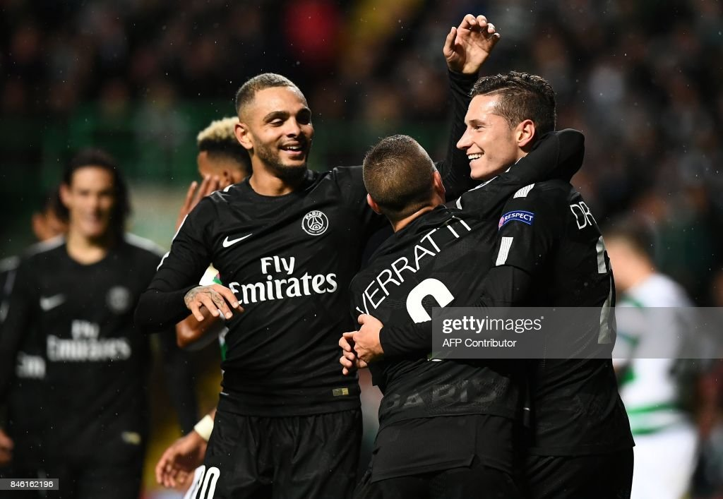 Paris Saint-Germain's German midfielder Julian Draxler (R) celebrates with teammates after creating the own-goal, PSG's fourth during the UEFA Champions League Group B football match between Celtic and Paris Saint-Germain (PSG) at Celtic Park in Glasgow, on September 12, 2017. PSG won the game 5-0. / AFP PHOTO / Franck FIFE