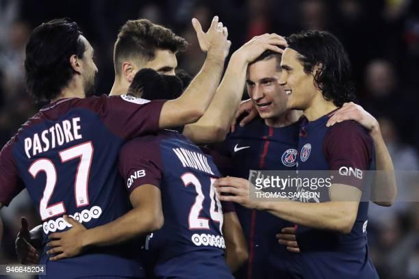 Paris SaintGermain's German midfielder Julian Draxler celebrates with teammates after scoring a goal during the French L1 football match between...