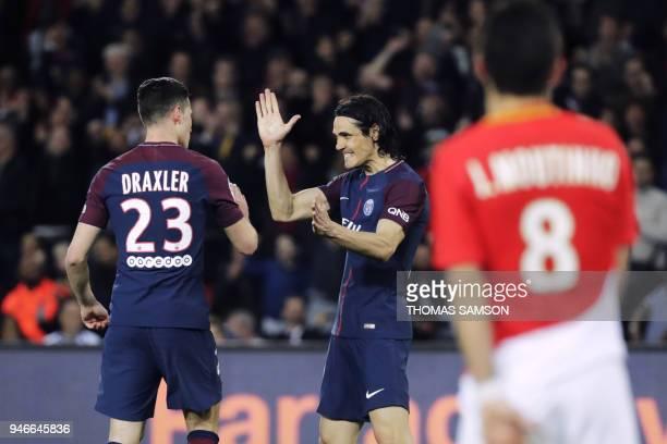 Paris SaintGermain's German midfielder Julian Draxler celebrates with Paris SaintGermain's Uruguayan forward Edinson Cavani after scoring a goal...