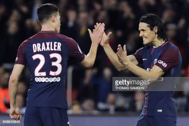 TOPSHOT Paris SaintGermain's German midfielder Julian Draxler celebrates with Paris SaintGermain's Uruguayan forward Edinson Cavani after scoring a...