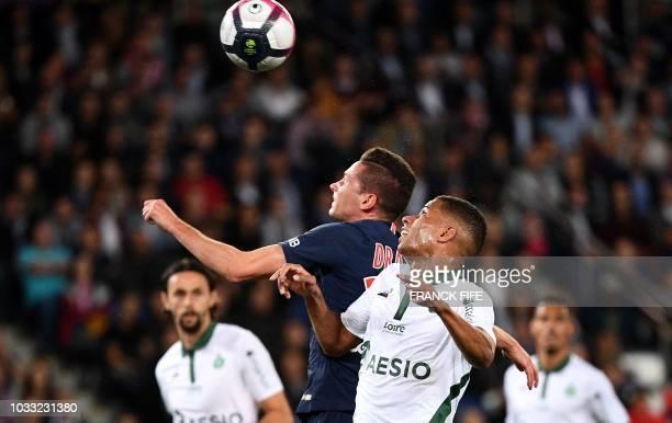 Paris Saint-Germain's German midfielder Julian Draxler heads the ball and scores a goal during the French L1 football match between Paris...
