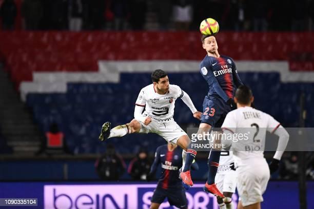 Paris Saint-Germain's German midfielder Julian Draxler heads the ball during the French L1 football match between Paris Saint-Germain and Stade...