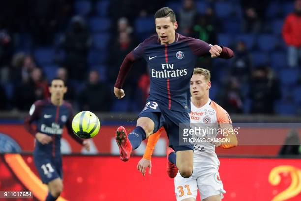 Paris Saint-Germain's German midfielder Julian Draxler jumps for the ball in front fo Montpellier's French defender Nicolas Cozza during the French...