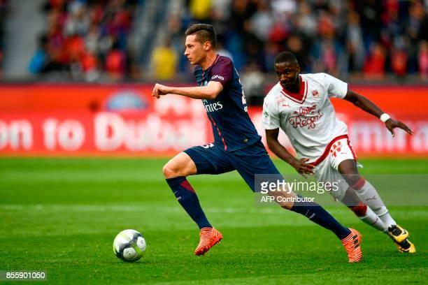 Paris SaintGermain's German midfielder Julian Draxler outruns Bordeaux's Senegalese midfielder Younousse Sankhare during the French L1 football match...