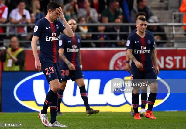 Paris SaintGermain's German midfielder Julian Draxler reacts after a goal scored by Reims during the French L1 football match between Reims and Paris...
