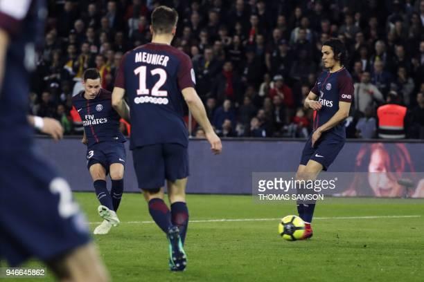 Paris SaintGermain's German midfielder Julian Draxler shoots and scores a goal during the French L1 football match between Paris SaintGermain and...
