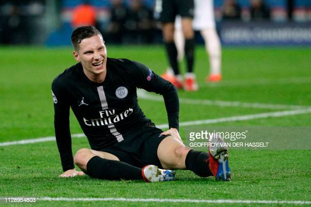 Paris SaintGermain's German midfielder Julian Draxler sits on the pitch after he gets injured during the UEFA Champions League round of 16 secondleg...