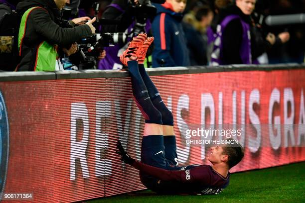 Paris SaintGermain's German midfielder Julian Draxler stretches his legs to ease the pain from cramps during the French L1 football match between...