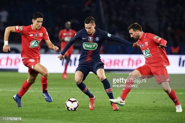 Paris SaintGermain's German midfielder Julian Draxler vies for the ball with Dijon's Moroccan defender Nayef Aguerd and Dijon's French midfielder...