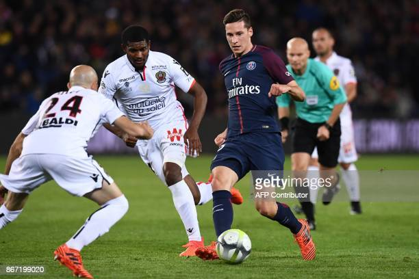 Paris SaintGermain's German midfielder Julian Draxler vies with Nice's French defender Christophe Jallet and Nice's Brazilian defender Santos Marlon...