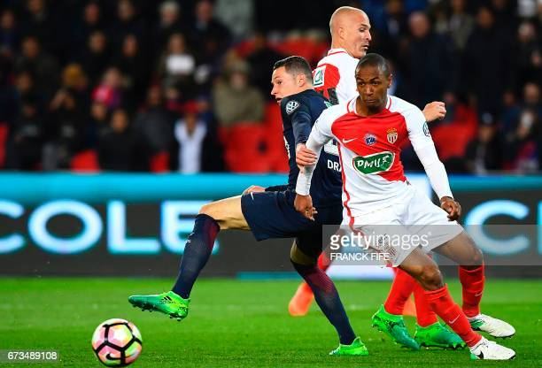 Paris SaintGermain's German midfielder Julian Draxler vies with Monaco's French defender Abdou Diallo during the French Cup semifinal match between...