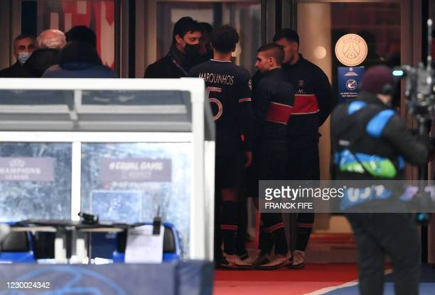 Paris Saint-Germain's Italian assistant sporting director Angelo Castellazzi speaks with Paris Saint-Germain's Brazilian defender Marquinhos and...
