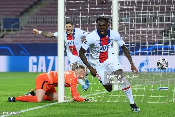 Paris Saint-Germain's Italian forward Moise Kean celebrates after scoring a goal during the UEFA Champions League round of 16 first leg football...
