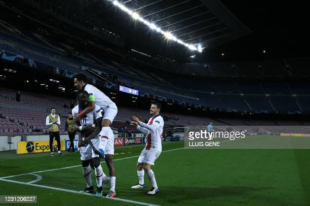 Paris Saint-Germain's Italian forward Moise Kean celebrates with teammates after scoring his team's third goal during the UEFA Champions League round...