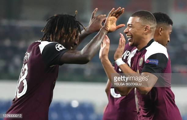 Paris Saint-Germain's Italian forward Moise Kean celebrates with Paris Saint-Germain's French forward Kylian Mbappe after scoring his team's first...