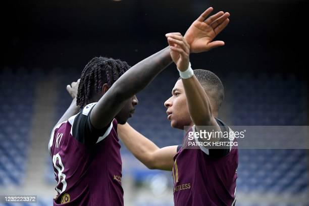 Paris Saint-Germain's Italian forward Moise Kean celebrates with Paris Saint-Germains French forward Kylian Mbappe following a goal during the French...