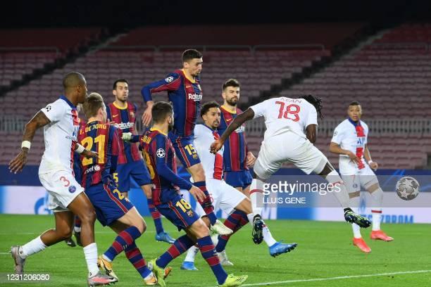 Paris Saint-Germain's Italian forward Moise Kean scores a header during the UEFA Champions League round of 16 first leg football match between FC...
