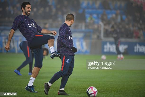 Paris SaintGermain's Italian goalkeeper Gianluigi Buffon and Paris SaintGermain's Italian midfielder Marco Verratti joke together as they take part...
